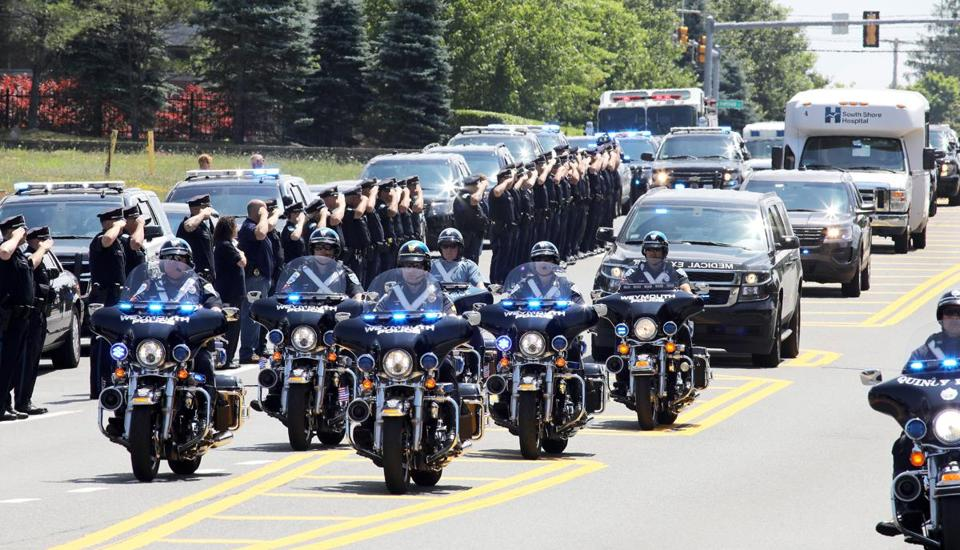 Police in Weymouth saluted along Main Street as the body of officer Michael Chesna was brought to the medical examiner's office in Boston.